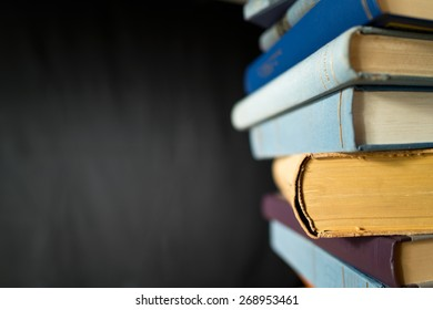 books in the bookshelf with black background
