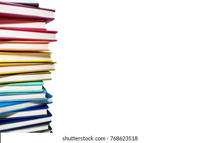 Books. A lot of books with bright covers in one pile isolated on white background. Place for text. Design element, paper and leather texture. Colorful books on the shelf, close up