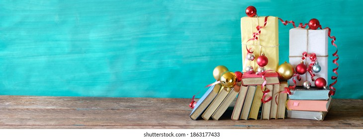 books as christmas gift,christmas present,reading,literature,education,making a gift, holiday concept,panoramic, free copy space