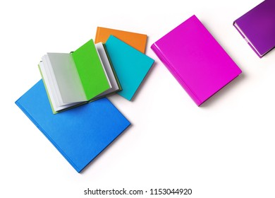 books with colored covers, top view