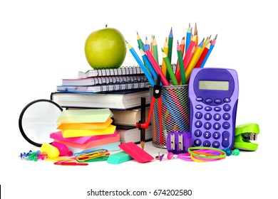 Books and a colorful assortment of school supplies isolated on a white background