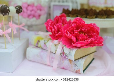 books decorated with red flowers