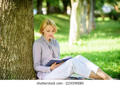 Books every girl should read. Girl concentrated sit park lean tree trunk read book. Reading inspiring books. Bestseller top list. Relax leisure an hobby concept. Best self help books for women.