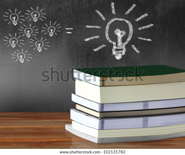 books in front of the a blackboard