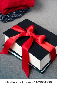 books gifts decorated with red ribbon, winter huggy seasonal concept, cristmas holidays gifts