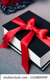 books gifts decorated with red ribbon, winter huggy seasonal concept, Christmas holidays gifts,