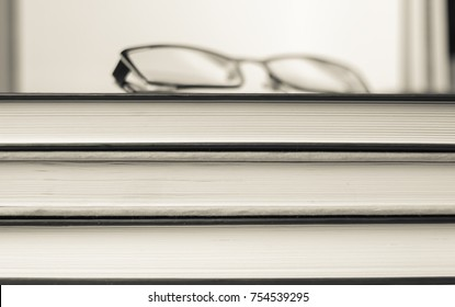 Books and glasses. The concept of education and knowledge.