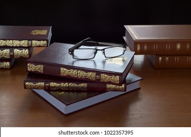 Books and glasses in the light