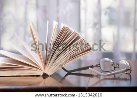 books and glasses over a wood table