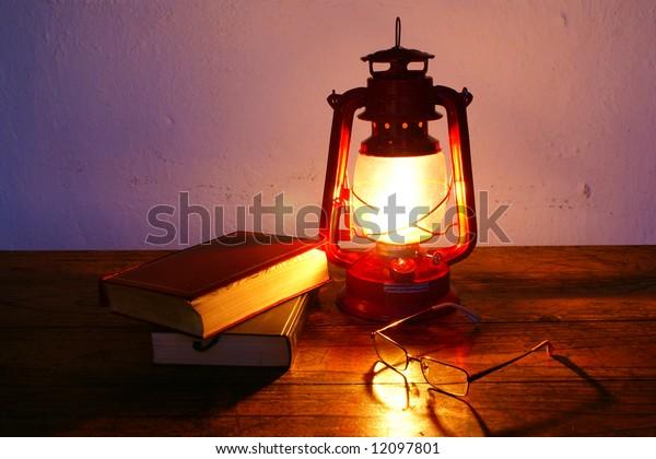 Books and hurricane lantern