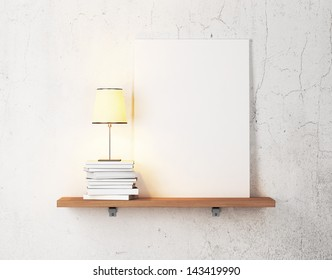 books, lamp and blank poster on a shelf