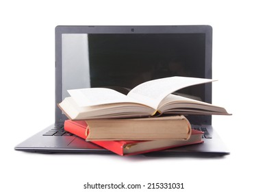 books and laptop isolated
