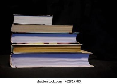 books lie on a black background