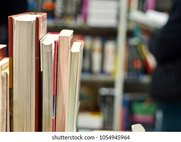 books are lined up in a bookstore