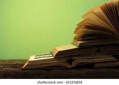 Books on an old wooden table