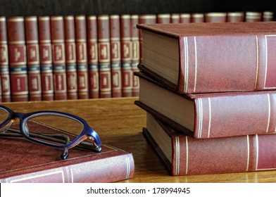 books on the table and classes and the bottom shelf