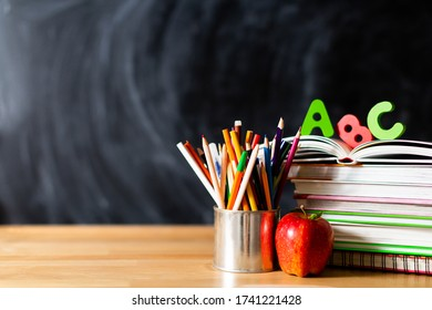 books on the table and pencils, ABC inscription, black board, image concept, schooling, no one - Shutterstock ID 1741221428