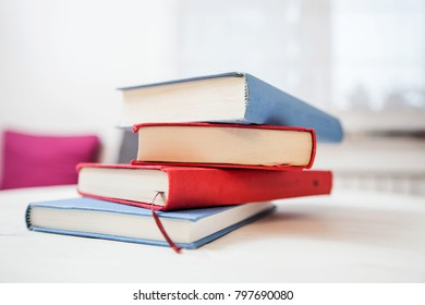 Books on white background at home, education and relax