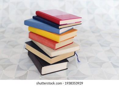 Books on a white table in a bookstore