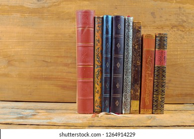 Books on wooden background. Old vintage books on wooden brown background. Copy space. Concept of the reading, education and still life.