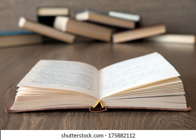 books on wooden deck tabletop