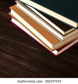 Books On Wooden Desk.