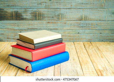 Books on the wooden old background