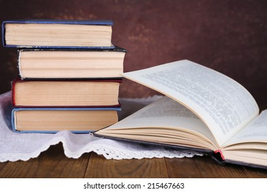 Books on wooden table on dark background