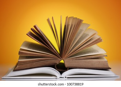 Books open on a bright background