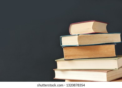 books pile on blackboard background, teacher's day concept