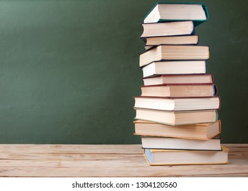 books pile on wooden table with copy space, teacher's day concept, education concept
