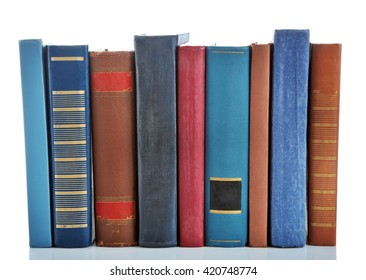 Books positioned in a line isolated on white