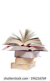 Books in a stack, isolated on a white background.