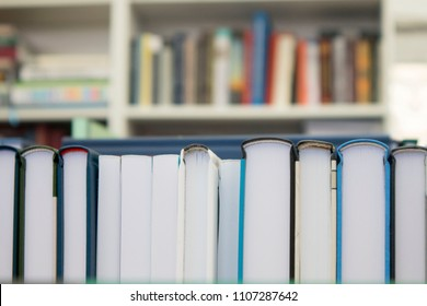books stacked on a shelf in a bookstore