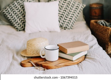 Books, straw hat and coffee cup. Breakfast in bed. Sweet home. Good morning. Atmospheric hygge style. flat lay, still life