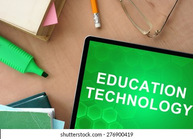 Books and tablet with words Education Technology