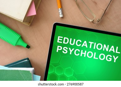 Books and tablet with words educational psychology