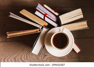 Books and tea at wooden table