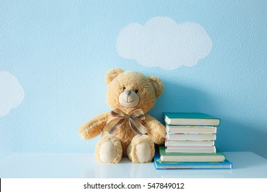 books and toy on a background of clouds and sky