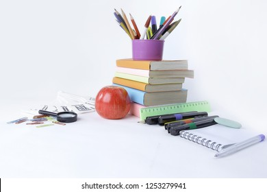 books and a variety of office supplies on white background .phot