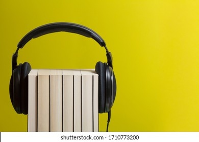 Books wearing headphones to listen to music for smart working or home study with audiobooks during the lockdown against coronavirus