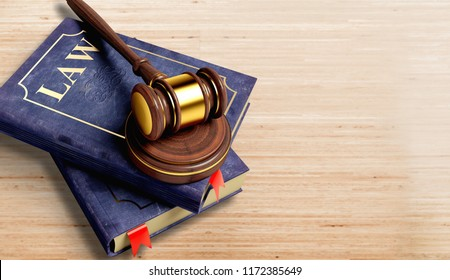 Books and wooden gavel on wooden table