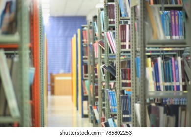 Bookshelf in library with many books. blurred photo