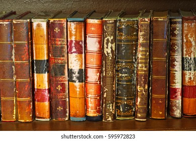 Bookshelf with old antique books. Books texture. Copy space