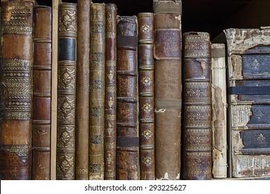 Bookshelf with row of antique books