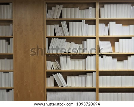 A Bookshelf Wall With Many Blank Paper Books