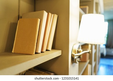 Bookshelves with books. Several different books on the shelves. Interior details in the library. Education and development, reading books and enlightenment. Soft focus and beautiful bokeh.