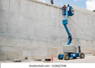 boom lift at water concrete tank construction site