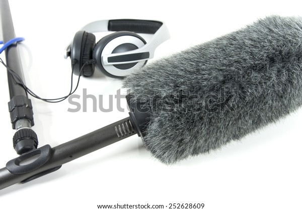 boom mic and headphones over white