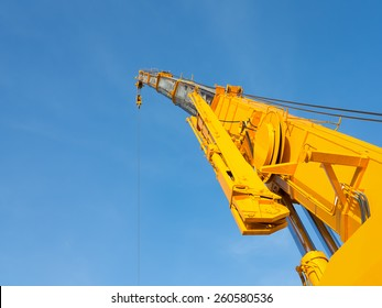 Boom of mobile crane with blue sky background.